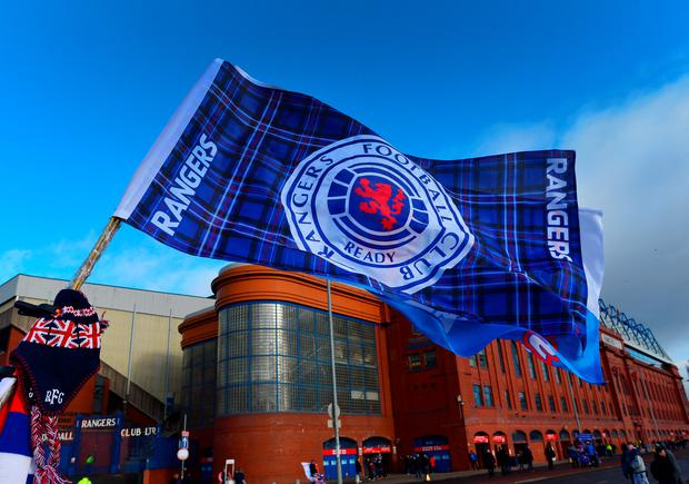 A Rangers flag flies outside Ibrox