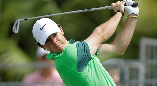 Rory Mcllroy drives from the first tee for the second time during the first round of the Honda Classic golf tournament, Thursday, Feb. 26, 2015 in Palm Beach Gardens, Fla. McIlroy scored a 6 on the par 4 hole.