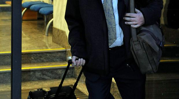 Accounts manager James McClellan, 53, from Maidston, Kent, leaving an employment tribunal in Kingsway, central London, after winning an unfair dismissal case against his former employer Dow Jones. Nick Ansell/PA Wire.