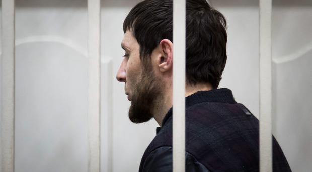 Zaur Dadaev, one of five suspects in the killing of Boris Nemtsov stands in a court room in Moscow, Russia, Sunday, March 8, 2015. (AP Photo/Ivan Sekretarev)