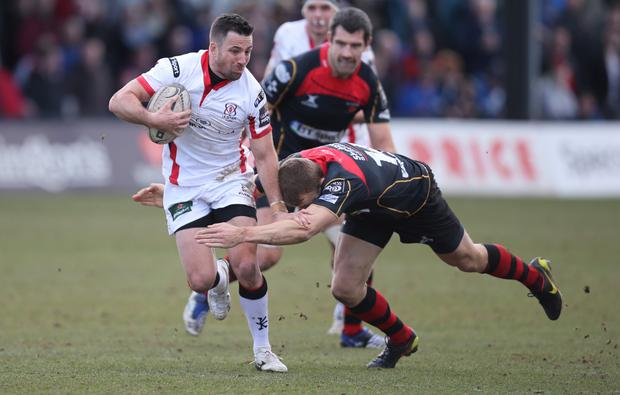Ulster's Ian Humphreys is tackled by Dragons' Tom Prydie. Chris Gareth Everett / Press Eye.