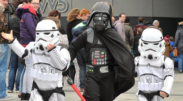 Alan Lewis - PhotopressBelfast.co.uk 7/3/2015 Mandatory Credit - Picture by Justin Kernoghan Young fans dressed in their Star Wars costumes arriving at a Star Wars exhibition in the W5 in Belfast this weekend. Thousands queued for hours to experience Irelands premier Star Wars costuming club, The Emerald Garrison, which returned to W5 for a weekend of fantastic costumes and photo opportunities. The event is open to the public this Saturday and Sunday.