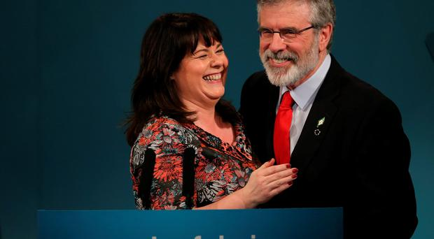 Sinn Fein MP Michelle Gildernew congratulates Sinn Fein president Gerry Adams after he delivered his keynote speech during the Sinn Fein Ard Fheis at the Millenium Forum, Londonderry. PRESS ASSOCIATION Photo. Picture date: Saturday March 7, 2015. Photo credit should read: Niall Carson/PA Wire