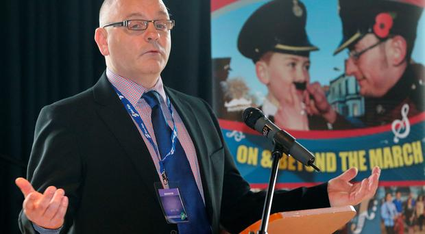 Derek Moore of The Londonderry Bands Forum speaks during a fringe meeting of the Sinn Fein Ard Fheis at the Millenium Forum, Londonderry. PRESS ASSOCIATION Photo. Picture date: Saturday March 7, 2015. Photo credit should read: Niall Carson/PA Wire