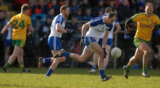 Paul Finlay, on the charge for Monaghan, with Colm Mc Fadden, closing in for Donegal, in the league game in O Donnell Park