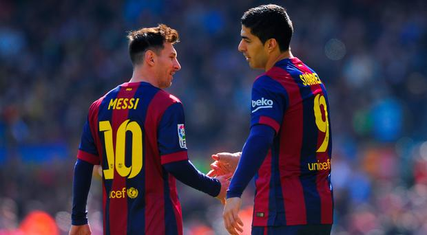 Luis Suarez (R) with teammate Lionel Messi of FC Barcelona