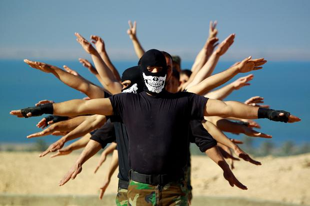 Fighters from the Iraqi Imam Ali Brigade, take part in a training exercise in Iraq's central city of Najaf on March 7, 2015. AFP/Getty Images