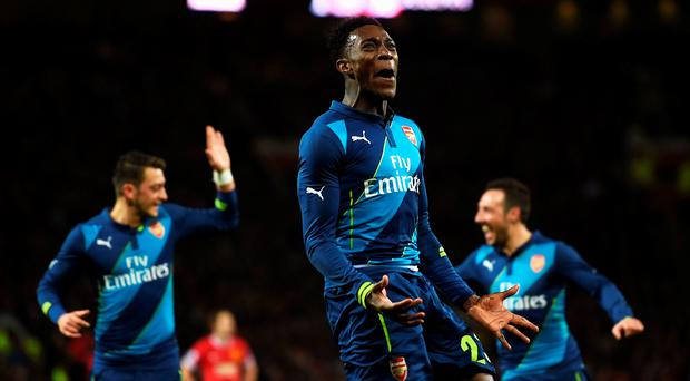 Top Gun: Danny Welbeck of Arsenal celebrates after scoring his team's second goal against Manchester United at Old Trafford