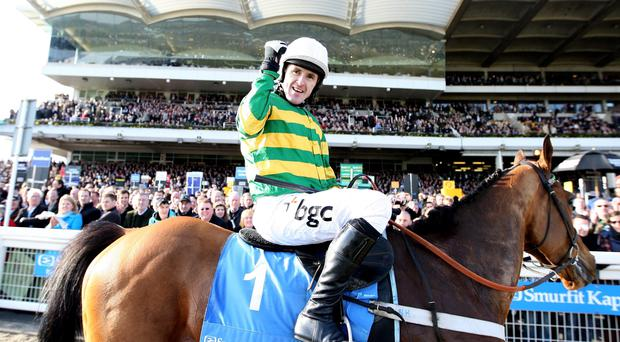 Tony McCoy celebrates winning The Smurfit Kappa Champion Hurdle Challenge Trophy on Binocular on Day One of the Cheltenham Festival on March 16, 2010