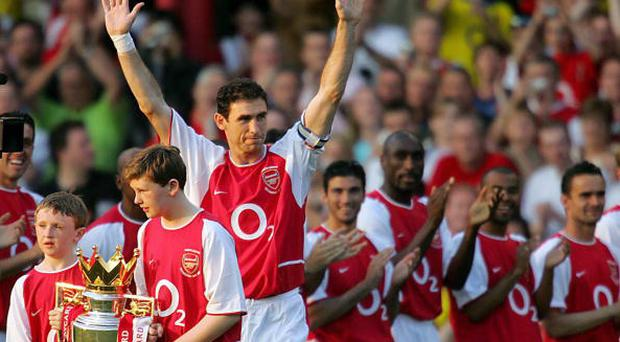 Arsenal's Martin Keown with his sons Niall (L) and Callum (2ndL)