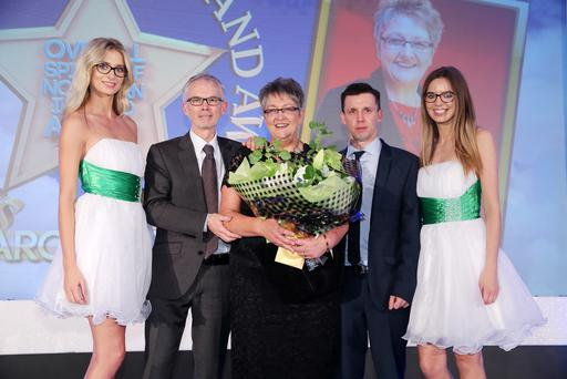 Overall Spirit of NI Winner 2014 Carol Doey pictured with Sunday Life editor Martin Breen and Tony McGinn (Specsavers).