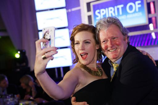 Spirit of Northern Ireland Awards 2014 at the Culloden Hotel Belfast. Niamh McGrady and Charlie Lawson.