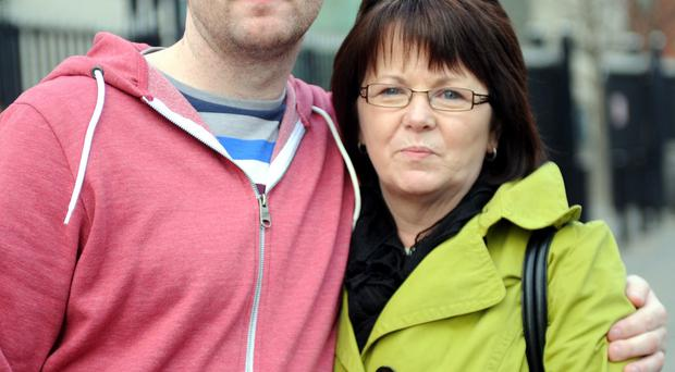 June McMullin and her son Johnnie outside court after Seamus Kearney was convicted of killing John Proctor