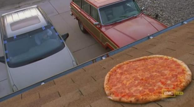 Walter White hurls a pizza onto the roof of his home in the memorable Breaking Bad scene