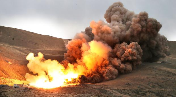 NASA and ATK conduct the first qualification ground test of the five-segment rocket motor that will be used for initial thrust for NASAs heavy-lift Space Launch System, which will enable new missions of exploration across the solar system Wednesday, March 11, 2015, in Promontory, Utah. (AP Photo/The Deseret News, Tom Smart)