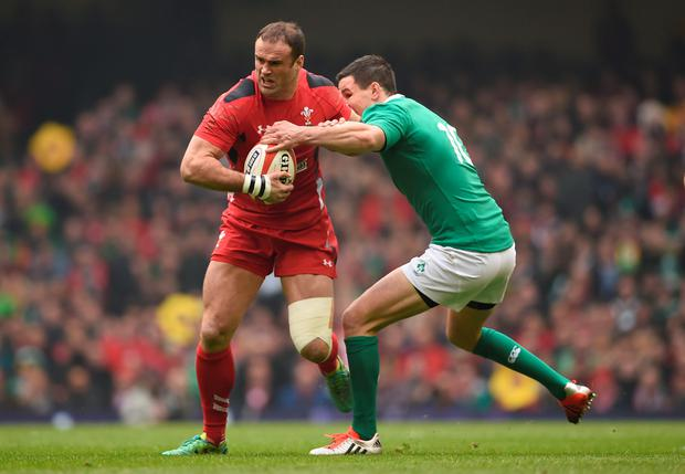 Wales' Jamie Roberts (left) goes past Ireland's Johnny Sexton (right) during the RBS 6 Nations match at the Millennium Stadium, Cardiff