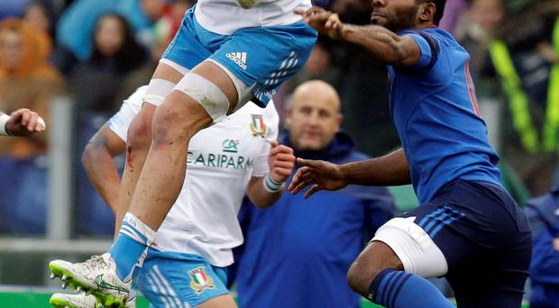 Italy's Sergio Parisse, left, jumps for the ball during a Six Nations rugby union match between Italy and France, at Rome's Olympic Stadium, Sunday, March 15, 2015. (AP Photo/Andrew Medichini)