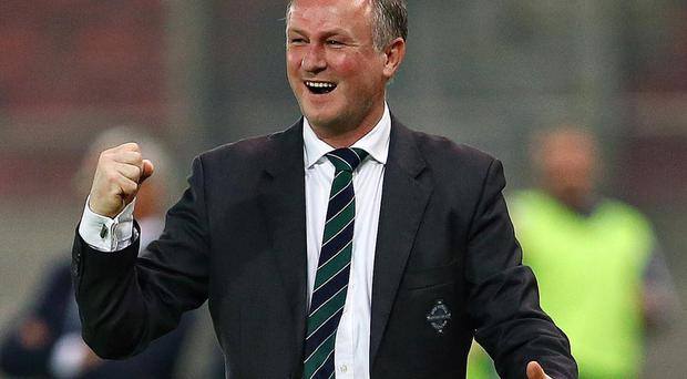 Northern Ireland manager Michael O'Neill celebrates Kyle Lafferty's goal against Greece