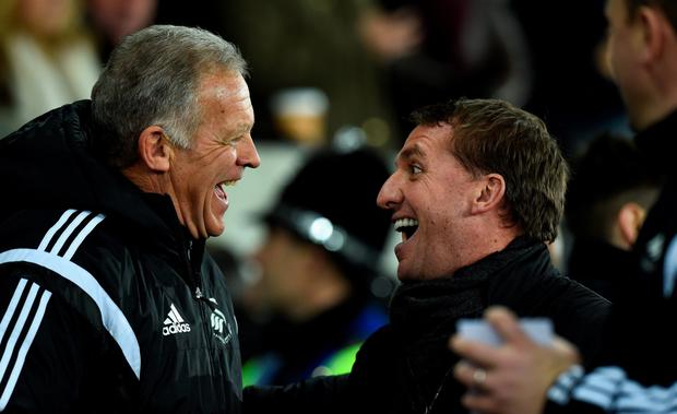 Liverpool manager Brendan Rodgers (r) shares a joke with Alan Curtis before the Barclays Premiership match between Swansea City and Liverpool at Liberty Stadium on March 16, 2015 in Swansea, Wales. (Photo by Stu Forster/Getty Images)