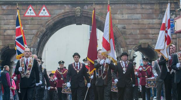 Members of the Apprentice Boys of Derry make their way through Ferryquay Gate. It is the first time that they organisation has paraded on St. Patrick's Day. Picture Martin McKeown.
