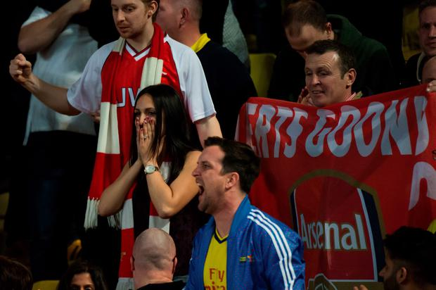 Arsenal's fans react during the UEFA Champions League football match Monaco vs Arsenal, on March 17, 2015 at Louis II stadium in Monaco.