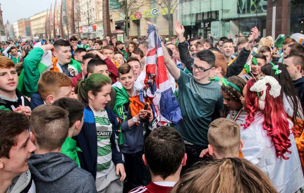 Picture - Kevin Scott / Belfast Telegraph Tuesday 17th March 2015 - Flag Burning Pictured is a republican youth burring a Union Jack flag that was stolen from a Flag Protester in Belfast Picture - Kevin Scott / Belfast Telegraph