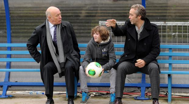 Sammy McIlroy with actors Art Parkinson (centre) and John Hannah during filming of Shooting for Socrates