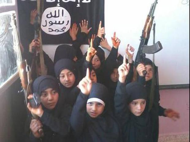 Recent pictures have also shown young girls posing with weapons