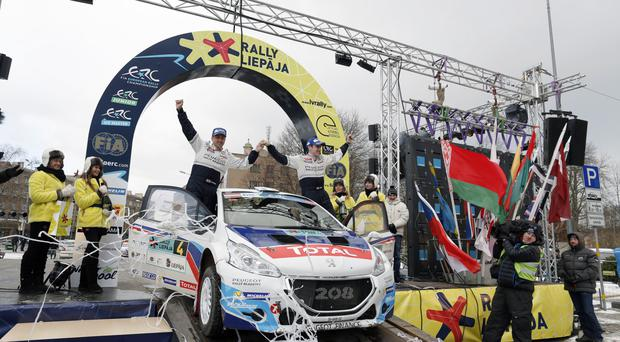 Craig Breen (right) and co-driver Scott Martin celebrate their European championship victory in Latvia
