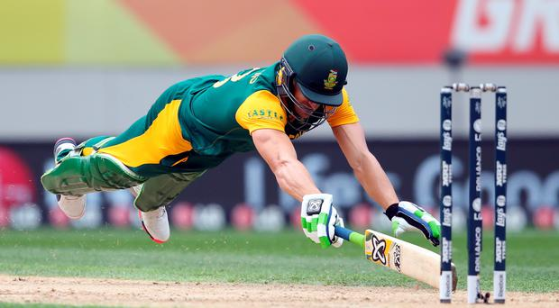 South Africa's Faf du Plessis dives in for a run