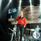 Charming man: Morrissey belts out one of his hits at the Odyssey last night