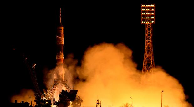 Russia's Soyuz TMA-16M spacecraft carrying the International Space Station (ISS) crew of US astronaut Scott Kelly and Russian cosmonauts Gennady Padalka and Mikhail Kornienko blasts off from the launch pad at Russian-leased Baikonur cosmodrome early on March 28, 2015. AFP PHOTO/KIRILL KUDRYAVTSEV/Getty Images.