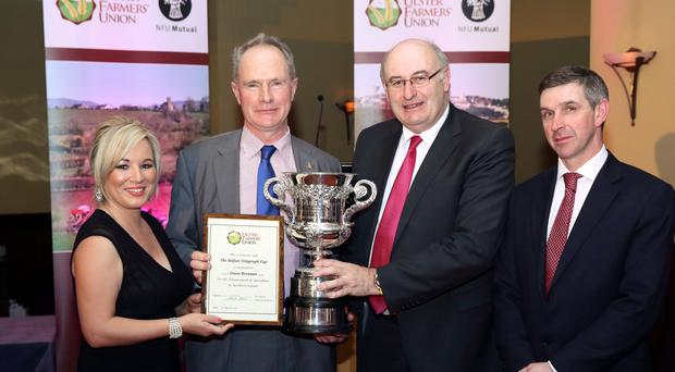 Agriculture Minister Michelle O'Neill, Owen Brennan, winner of the Belfast Telegraph Cup, EU Farm Commissioner Phil Hogan and UFU president Ian Marshall, at the UFU annual dinner in Newry on Friday evening