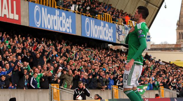 Northern Ireland Kyle Lafferty celebrates scoring his first goal against Finland during Sunday's UEFA EURO 2016 Group F Qualifier at Windsor Park. Brian Little/Presseye.