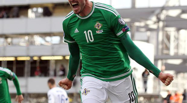 Northern Ireland's Kyle Lafferty celebrates his second goal during today's game at Windsor Park in Belfast. David Maginnis/Pacemaker Press.