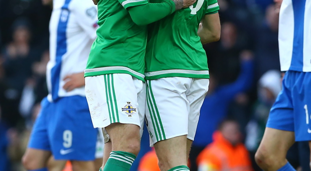 Northern Ireland's Oliver Norwood and Jonny Evans celebrate after defeating Finland 2-1 in Sunday's Euro 2016 Qualifier at Windsor Park