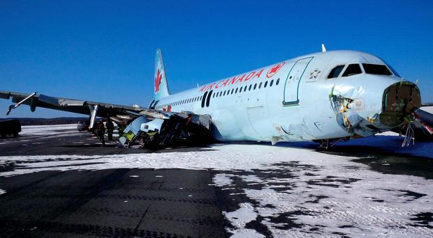 This photo provided by the Transportation Safety Board of Canada shows a Air Canada Airbus A-320 at Halifax International Airport after making an