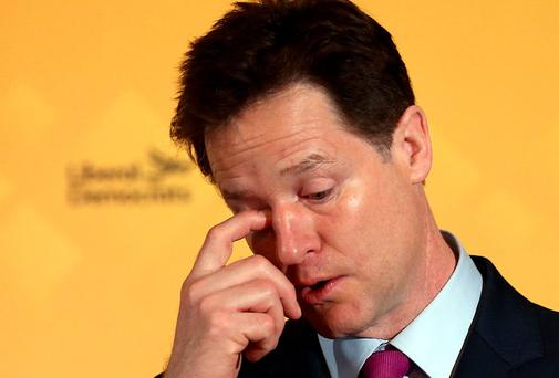 LONDON, ENGLAND - MARCH 31: Nick Clegg, the leader of the Liberal Democrat party, wipes his eye as he speaks while launching his party's NHS manifesto at a press conference on March 31, 2015 in London, England. The leader launched the Liberal democrat party's NHS manifesto on the second day of campaigning in what is predicted to be Britain's closest national election in decades. (Photo by Carl Court/Getty Images)