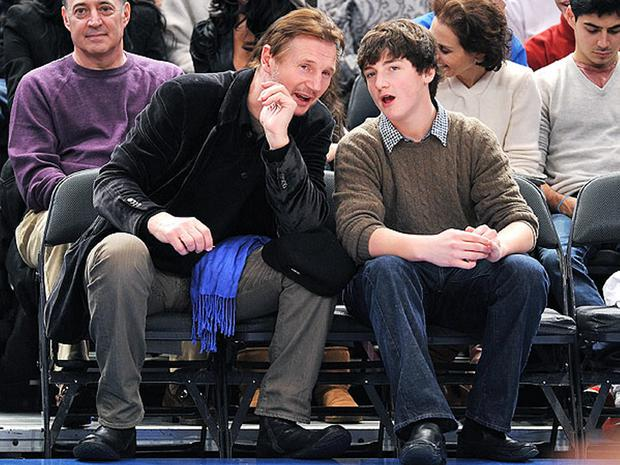 Liam Neeson enjoying a game with son Micheal