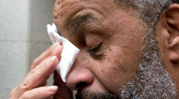 Anthony Ray Hinton wipes away tears after greeting friends and relatives upon leaving the Jefferson County jail, Friday, April 3, 2015, in Birmingham, Ala. (AP Photo/ Hal Yeager)