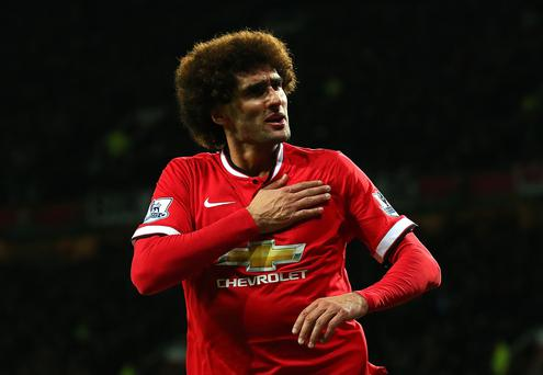 United he stands: Marouane Fellaini did not get a Premier League game until the end of October is is now considered by Louis van Gaal as undroppable