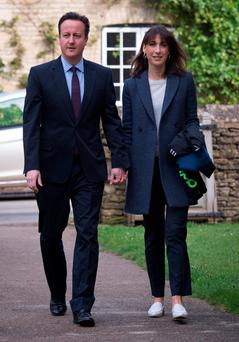 Prime Minister David Cameron and his wife Samantha arrive at St Nicholas Church in Chadlington, Oxfordshire, where he attended an Easter Sunday service. Stefan Rousseau/PA Wire.