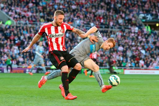 Sunderland's Connor Wickham (left) is tackled by Newcastle United's Jack Colback during the Barclays Premier League match at the Stadium of Light, Sunderland. Richard Sellers/PA Wire.