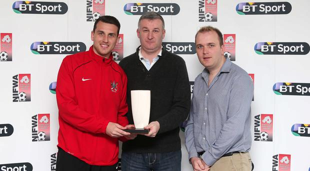 From left to right: Stephen O'Neill of Ards receives his Belfast Telegraph Championship One Player of the Month Award from Patrick Bradley, BT Sport with Paul Fergsuon, NIFWA