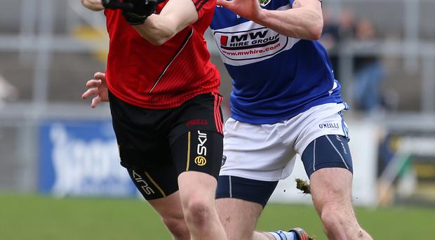 Under pressure: Down's Donal O'Hare goes on the attack