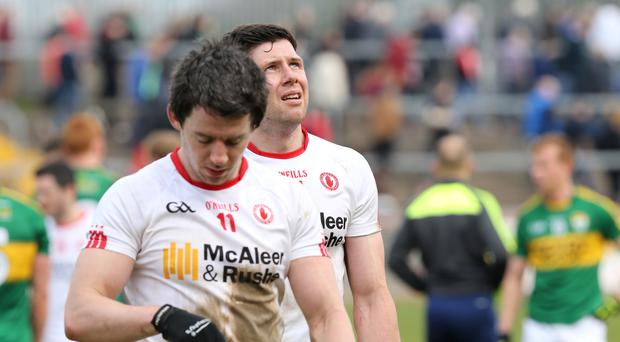 Down and out: Tyrone's Sean Cavanagh and Mattie Donnelly feel the pain of relegation