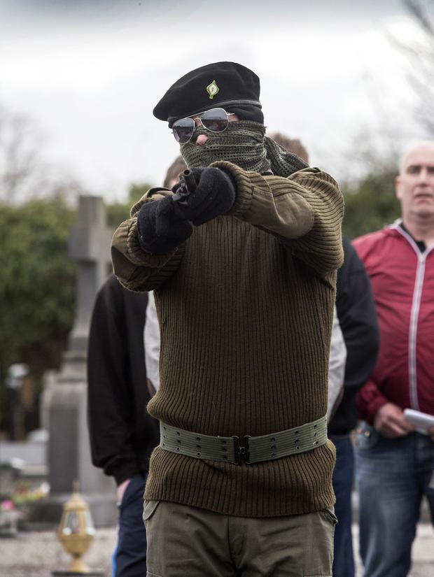 A masked CIRA gunman fired a volley of shots over the republican plot during a continuity IRA show of strength in St Colmans Graveyard, Lurgan. 04/04/15