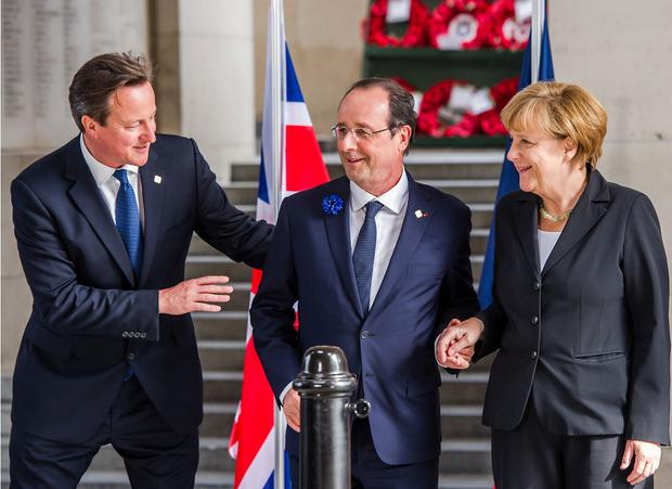 David Cameron, with the French President François Hollande and German Chancellor Angela Merkel, is under pressure to say he is prepared to urge an 'out' vote in a referendum