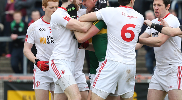 Pressure mounts: Tyrone's Ronan McNamee clashes with Kieran Donaghy as the Red Hands crash through relegation trapdoor