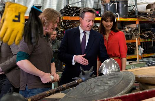 Prime Minister David Cameron and his wife Samantha visit the Titanic Studios in Belfast, where they saw the film sets for the TV drama Game of Thrones.